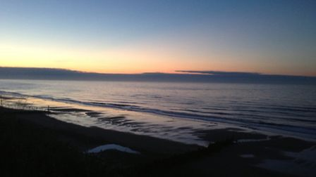 10pm the sun has just gone down, looking at a calm sea from the cliff top at Mundesley.