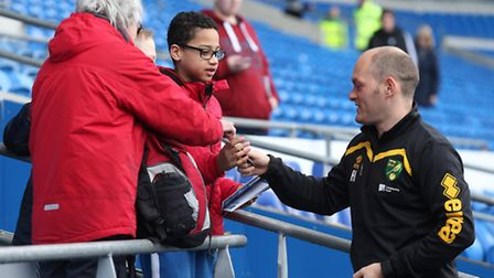 Some autograph hunters were keen to get the signature of Norwich boss Alex Neil at Cardiff. Picture