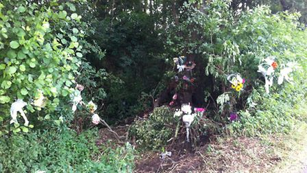 Tributes have been left at the scene of a crash on Severalls Road in Methwold Hythe, in which two pe