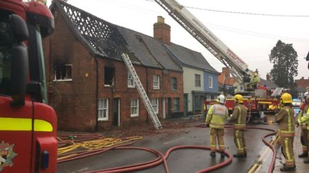 Fire fighters work to put out blaze in Harleston. Picture Twitter/NorfolkEastDLOs