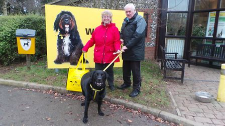 Chunky Charlie, who needs to lose some weight, and his new adopters Maureen and Michael Briggs. Pict