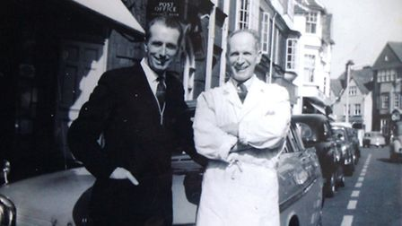 Len Fiske (left) outside the North Walsham butchers shop he worked at, with wartime pal Paddy Flemin