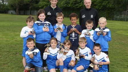 Attleborough Town FC players with showing off their end of season trophies