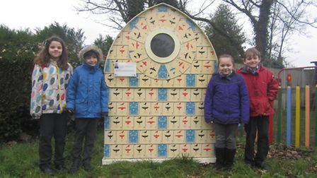 The birdhouse arrives at Browick Road Primary School in Wymondham. Pupils, from left, Evie Westwood,