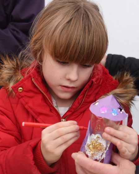 Children enjoying the activities at the Seething Observatory. Daisy-May Wonnacott, seven, concentrat