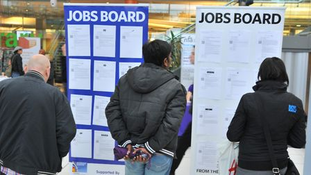 Visitors to a jobs fair examine what's on offer. Picture by SIMON FINLAY.
