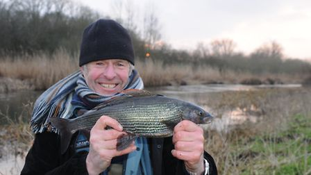 John Bailey with a fabulous Frome grayling.