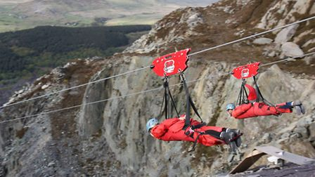 Two of the NNAB team taking part in the zip wire challenge last year. Picture: Newman Associates