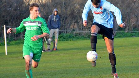 Aiden Lowe scores his third goal as Bungay Town beat Holt 5-0. Photo: Shaun Cole.