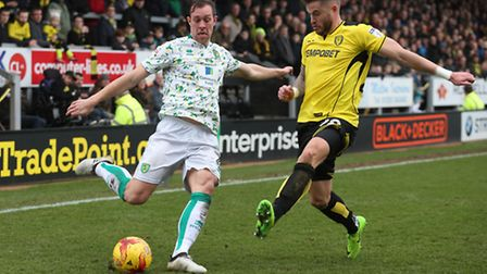 Steven Whittaker attempts a cross as he's defended by Burton's matchwinner, Michael Kightly. Picture