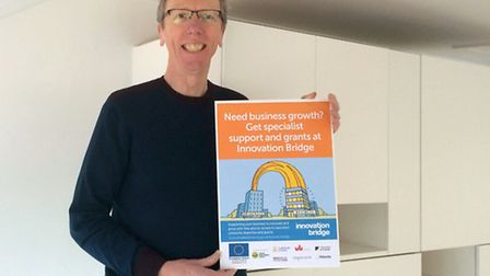 Mark Greenwood of Greenwood&Bell with the finished branding for Innovation Bridge. Picture: GREENWOO