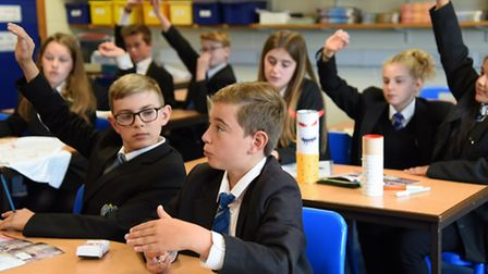 Pupils at Northgate High School eager to join in a discussion during their personal, social and heal