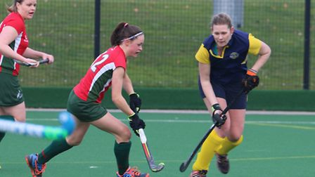Young Lara Taylor in the thick of the action for Norwich Dragons against Maidstone in the East Leagu