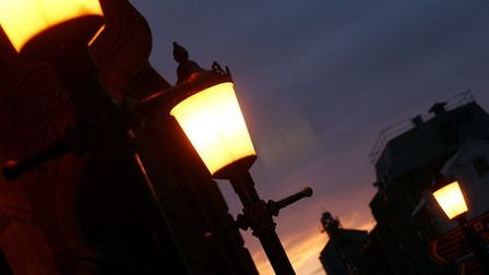 2/3 Lighting-up time: The street lights switch on as the Sunsets over Yarmouth. Pic.. Nick But
