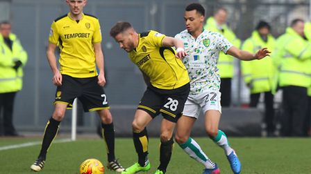 Michael Kightly fends off Jacob Murphy at Pirelli Stadium. Picture: Paul Chesterton/Focus Images