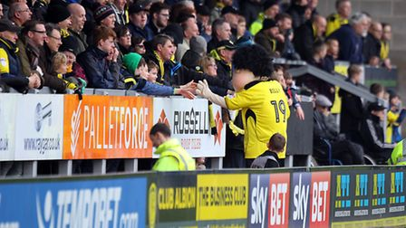 The Burton mascot celebrates with the home crowd after Cauley Woodrow opened the scoring against the