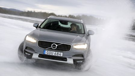 Volvo?s new V90 Cross Country estate car getting to grips with powering over the icy surface of a fr