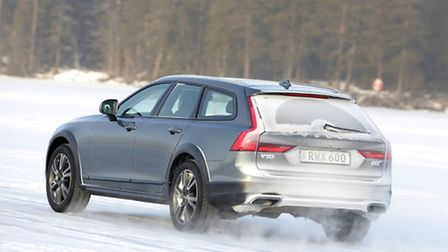 Volvo's new V90 Cross Country estate car getting to grips with powering over the icy surface of a fr