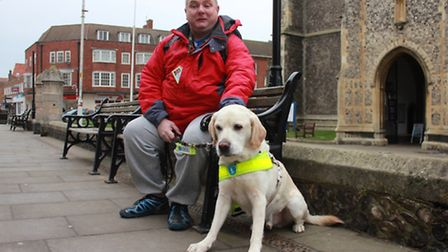 Paul Monaghan and his guide dog Gizmo, who are backing an appeal for volunteers fundraisers in the C