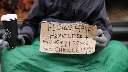 File photo dated 18/03/16 of Lucas, a homeless man, holding a sign reading 'Please help, homeless an