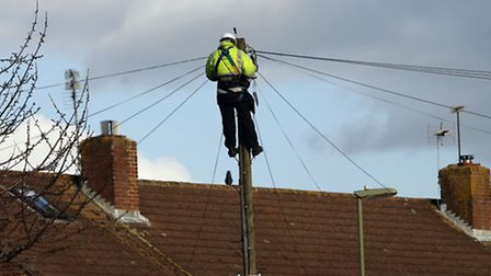 File photo dated 02/02/16 of a BT Openreach engineer working on telephone lines in Havant, Hampshire