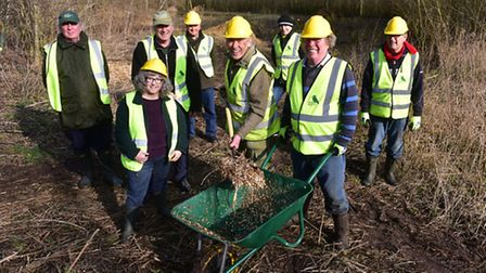 River Waveney Trust volunteers help to renovate a small park off Sawmills road, Diss. Picture: NICK