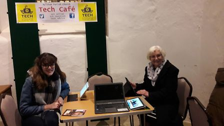 A young volunteer helping a visitor at Aylsham tech cafe. Picture: AYLSHAM PARISH CHURCH