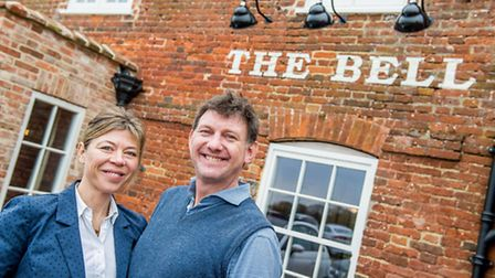 The Bell at Brisley has been awarded the Pub is the hub plaque. From front left, Owners Amelia Nicho