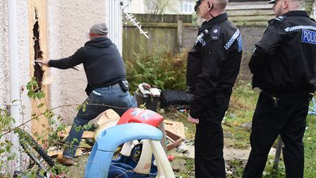 Police break into a house on Keyes Close for Operation Gravity searching for suspected drugs users.