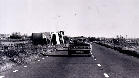 Lorry is overturned on the Acle Straight following the 1987 storm. Photo from Archant Library.