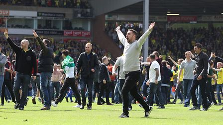 Fans celebrate by running onto the pitch after Norwich win at the Sky Bet Championship match at Carr