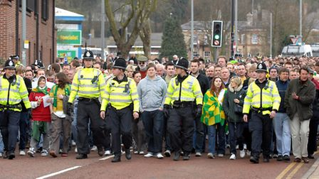 Police escort fans at the East Anglian Derby in 2008 at Portman Road . Norwich Fans walking to the g