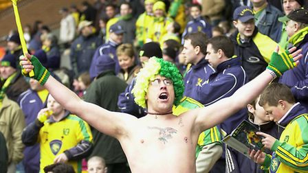 One very happy fan entertains the crowd in his NCFC colours wig in 2004 at the NCFC v Ipswich Town m