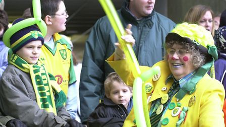 Children are entertained by green and yellow balloon animals in 2004. Photo: Steven Key.
