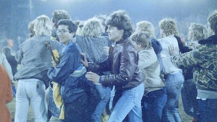 Fans celebrate by running onto the pitch after NCFC 2 V Ipswich Town 0 on 6th March 1985. Photo: Arc