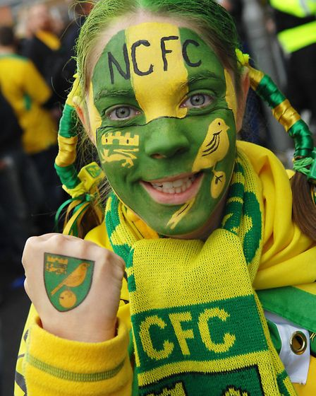 A young fan shows of her NCFC get up at the East Anglian Derby at Portman Road in 2008. Picture:
