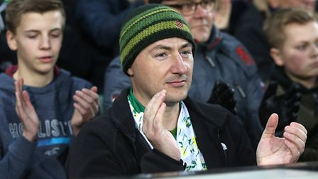 Fans take part in a minutes applause for Actor and Norwich fan John Hurt during the Sky Bet Champion