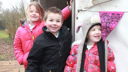 Erpingham Primary pupils Florence, Simon and Beth pose for a photo outside the new pre-school centre