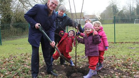 Erpingham Primary pupils helping north Norfolk MP Norman Lamb plant a tree to celebrate the opening
