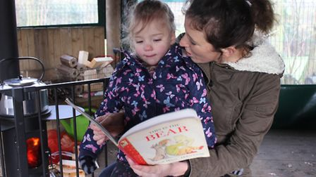 Sharing a story in the wooden amphitheatre at Erpingham Primary's new Little Brown Hare pre-school.