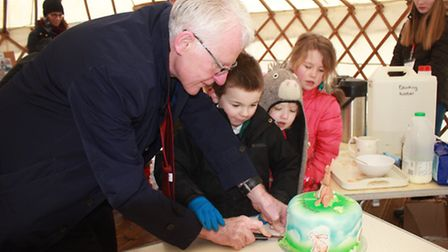 Cutting the cake at the opening of Erpingham Primary's new pre-school centre. Picture: KAREN BETHELL