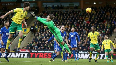 Timm Klose rises highest to head home Robbie Brady's cross for Norwich City's second goal. Picture b