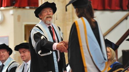 Students celebrate and enjoy the graduation ceremony for Norwich University of the Arts at St Andrew