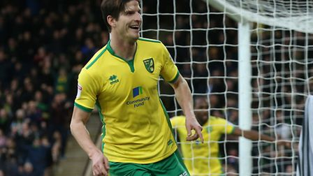 Timm Klose celebrates heading Norwich 2-0 in front against Birmingham.