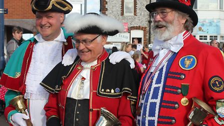 Sheringham town crier Andrew Cunningham Brown (left) with his predecessor Tony Nelson (right) and Cr