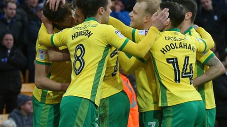 Timm Klose is mobbed after his header in Norwich City's 2-0 Championship win over Birmingham City.