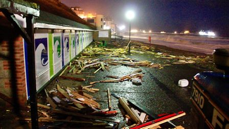 Beach huts in Cromer were destroyed by the sea during the storm surge. Picture: Ady Woods