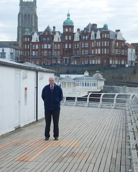 North Norfolk District Council leader Tom FitzPatrick inspects the repairs to Cromer Pier. Picture:
