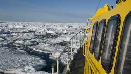 'Polar Bound' threading her way through leads in the pack ice in Prince Regent inlet.