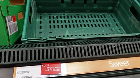 Empty iceberg lettuce shelves at a Tesco store (Picture: PA)